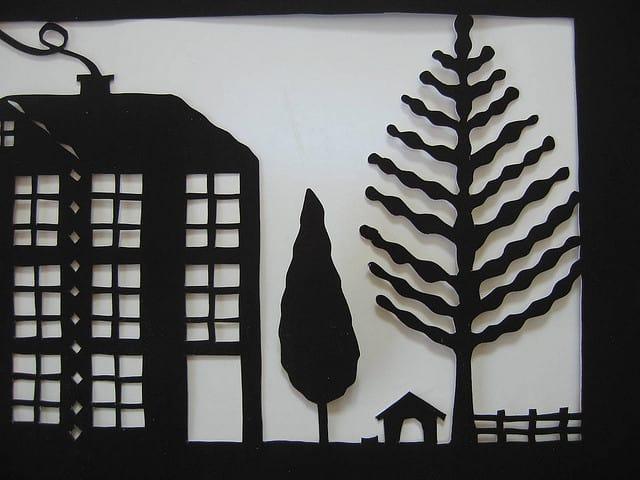 Folk art tree and dog house papercutting